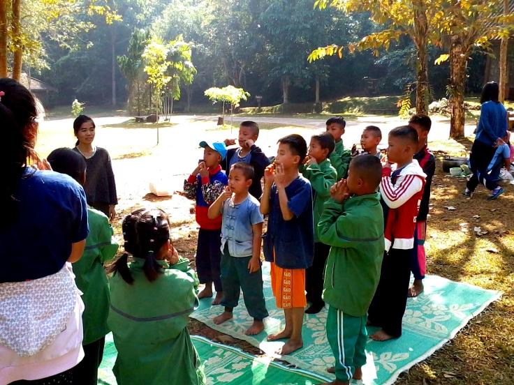 Teacher Thoeng teaching kindergarten during our trip to Tam Luang.