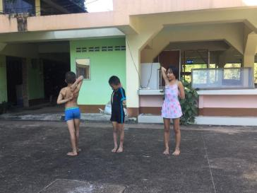 Stretching before swim practice at the Swimming Home